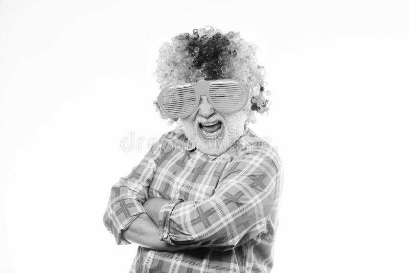 Crazy party man. mature bearded man in colorful wig and party glasses. anniversary holiday. Crazy man in playful mood royalty free stock photos