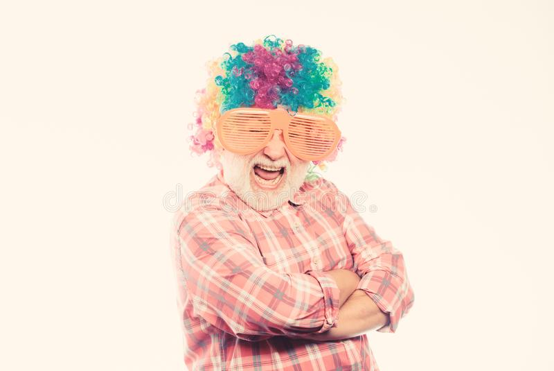 Crazy party man. mature bearded man in colorful wig and party glasses. anniversary holiday. Crazy man in playful mood stock photos