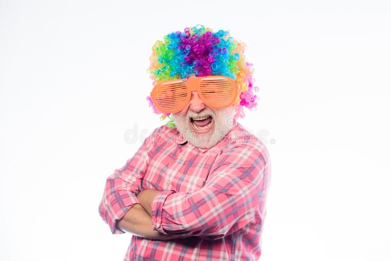 Crazy party man. mature bearded man in colorful wig and party glasses. anniversary holiday. Crazy man in playful mood royalty free stock image