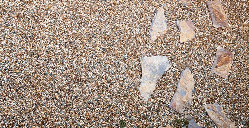 Crazy paving laid as ornamental stepping stones stock photos
