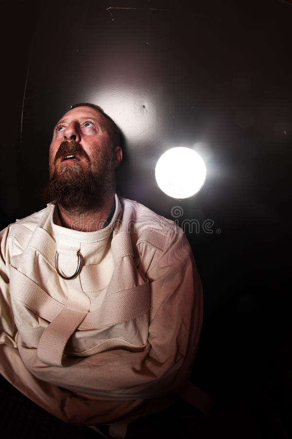 Crazy person in a straitjacket royalty free stock photos