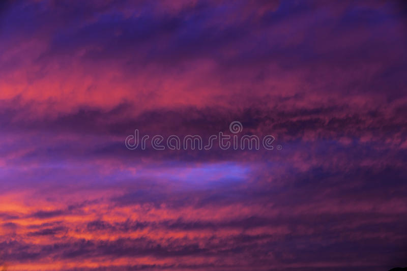 Crazy Pink Clouds. Light up up the afternoon sky stock photography