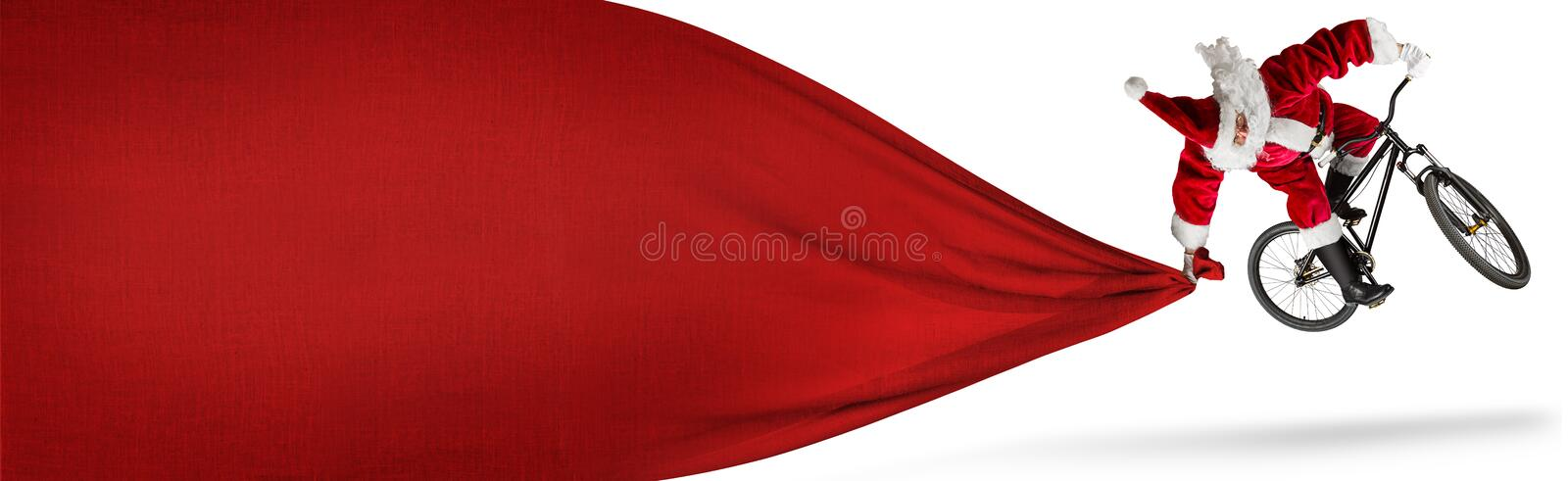 Crazy santa claus jump on dirt mountain bike with big huge red b royalty free stock photos