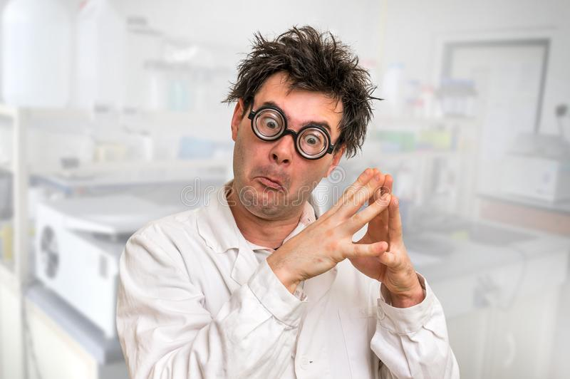 Crazy scientist with glasses thinking about his experiment royalty free stock photography