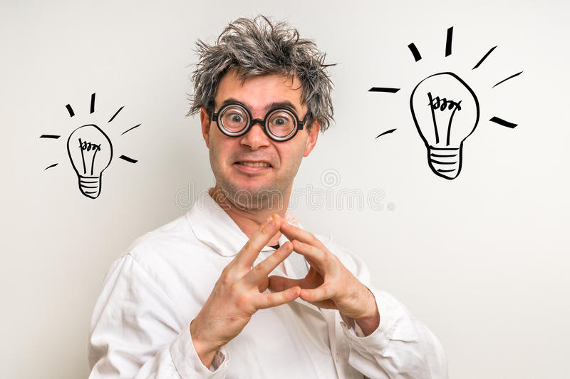 Crazy scientist got the great idea with bulb symbol royalty free stock photo