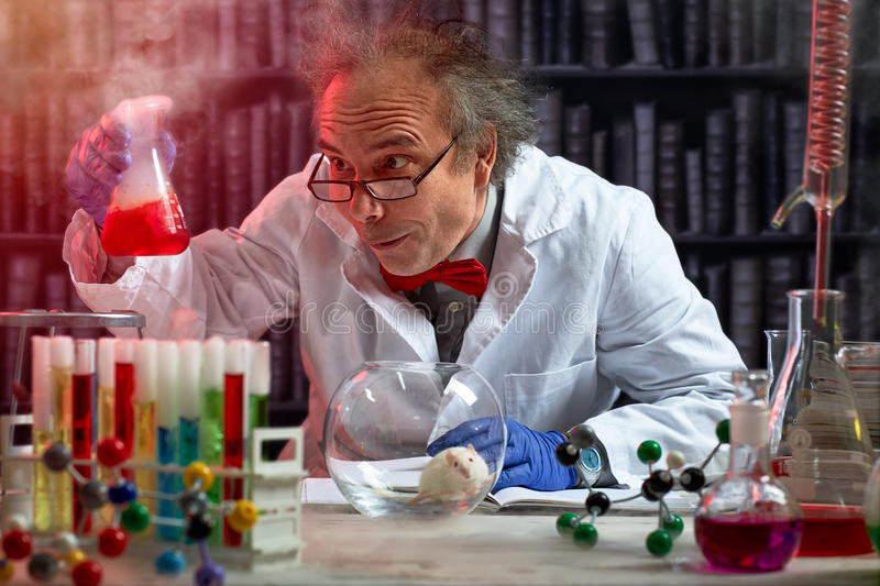 Crazy scientist the making mix of chemicals royalty free stock photos