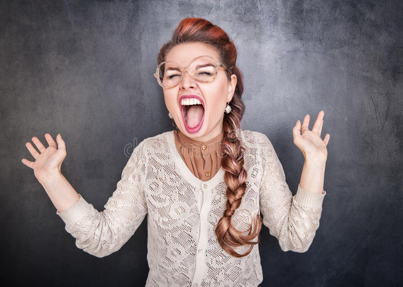 Crazy screaming woman stock images