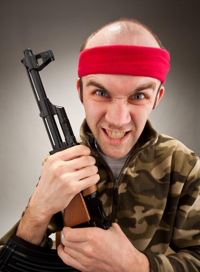 Crazy soldier with machine gun stock image