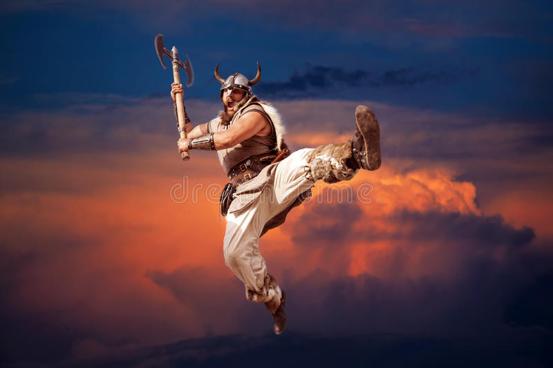 Crazy strong viking attacking from sky, sunset. royalty free stock images