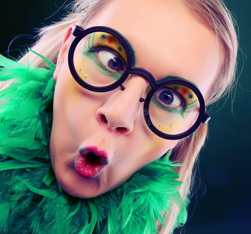 Crazy woman with creative visage close up stock photo
