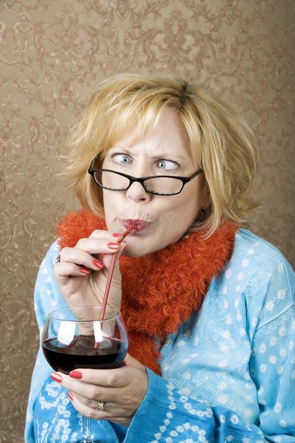 Crazy Woman Drinking Wine stock photos