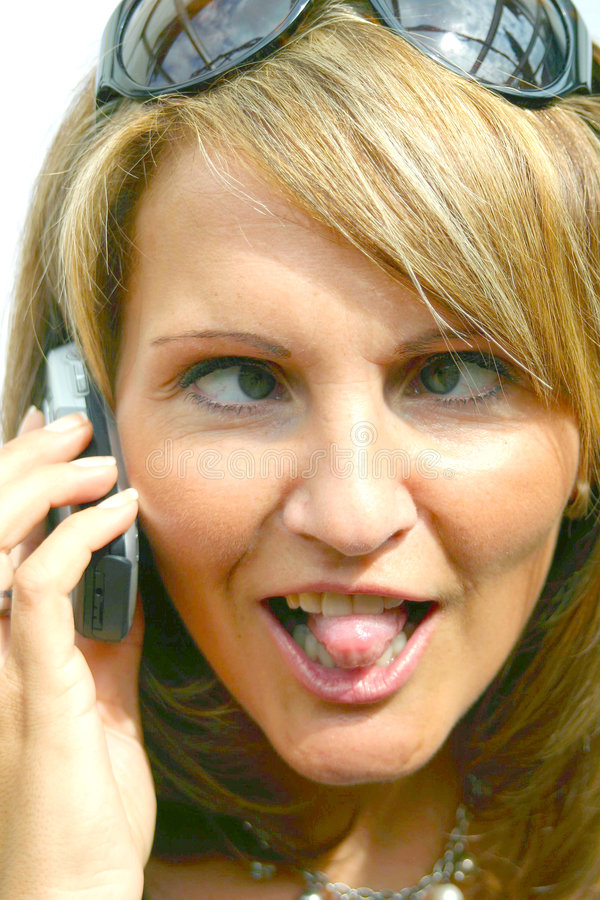 A crazy Woman with phone. A crazy Woman with a mobile phone royalty free stock images