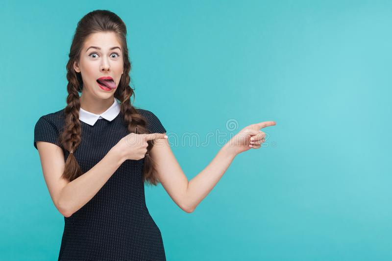 Crazy woman pointing finger at copy space. stock photo