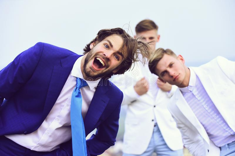 Crazy work. happy man and twins guys in outfit, agile business, success. Crazy work. businessmen. happy men or bearded businessman and twins guys in business stock photo