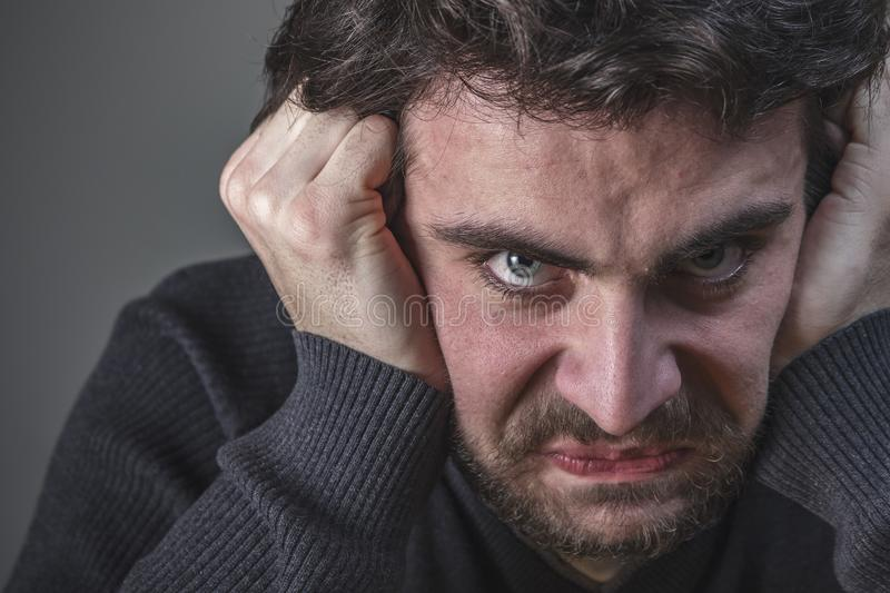 Deranged angry young man. Crazy young man, deranged and insane, mentally ill stock image