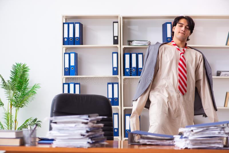 The crazy young man in straitjacket at the office royalty free stock photography