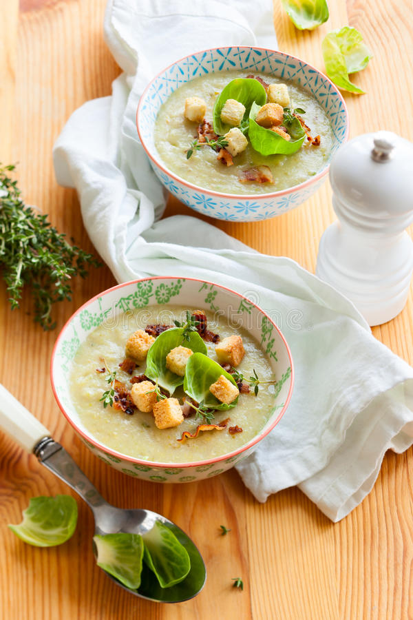 Cream of brussel sprout soup. Cream of brussel sprout with potato and bacon soup royalty free stock photography