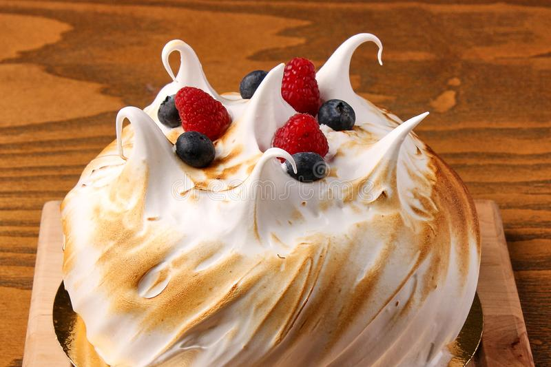 Cream cake with berries, raspberries and blueberries, bun, pastry royalty free stock images