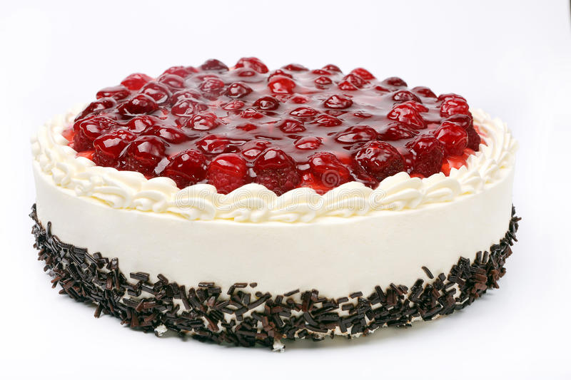 Cream cake with cherries on white background.  royalty free stock image