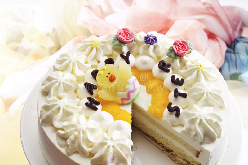 Cream cake, Easter cake, marzipan carrots, Merry Easter writing royalty free stock photography