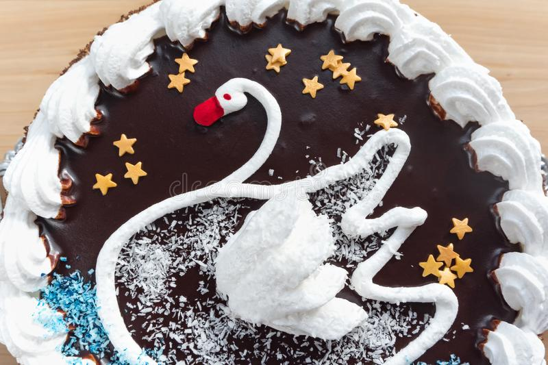 Cream cake with the image of a Swan. Detail. Cream cake with the image of a Swan. Detail stock images