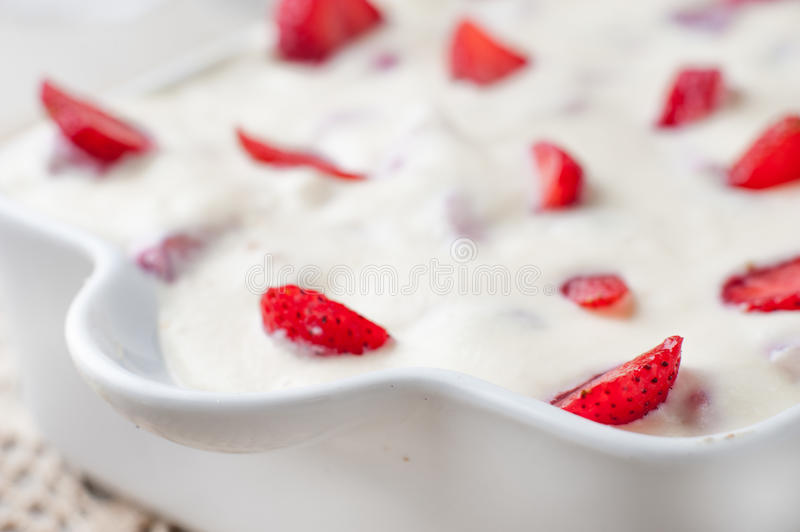 Cream cake with strawberries in a pan stock photo