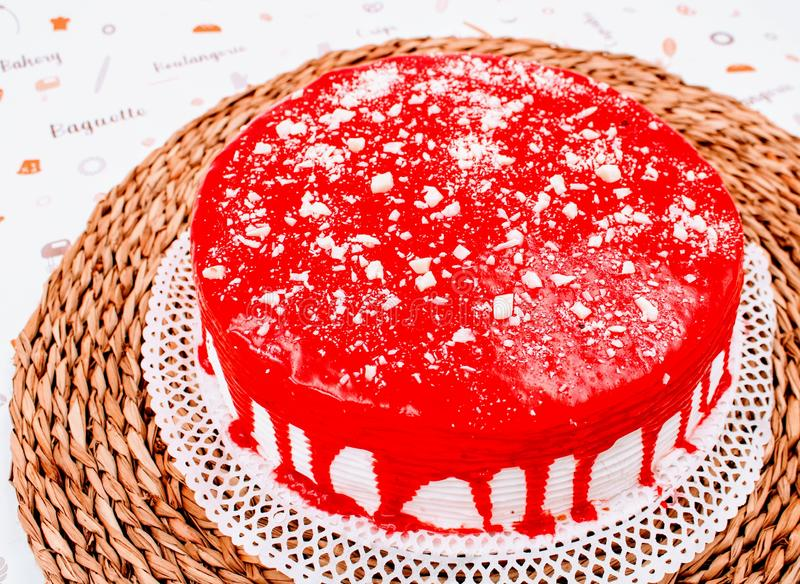 Cream cake with strawberry syrup. And white chocolate shavings royalty free stock photos