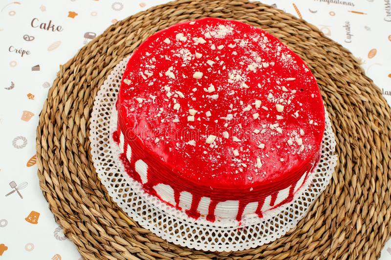 Cream cake with strawberry syrup. And white chocolate shavings royalty free stock photography