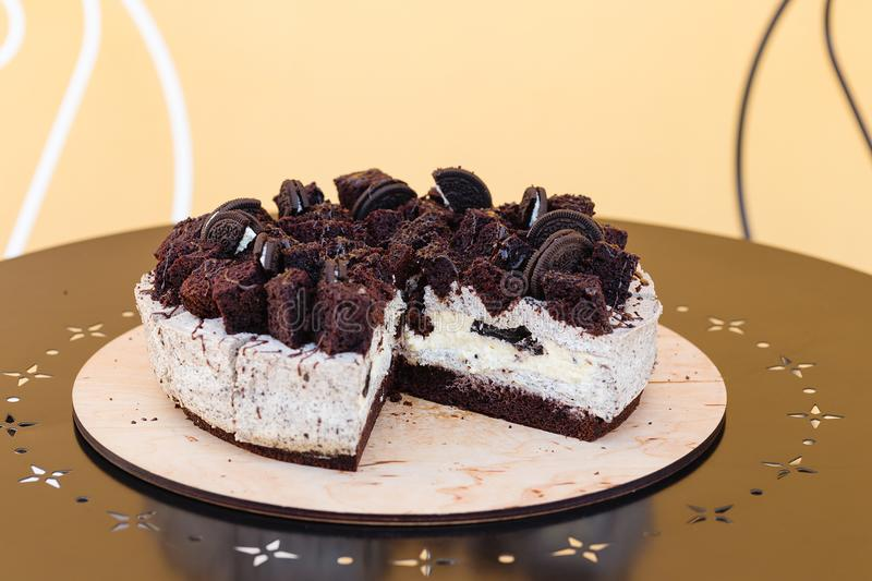 Cream cheese cake with chocolate cookies and brownies stock photography