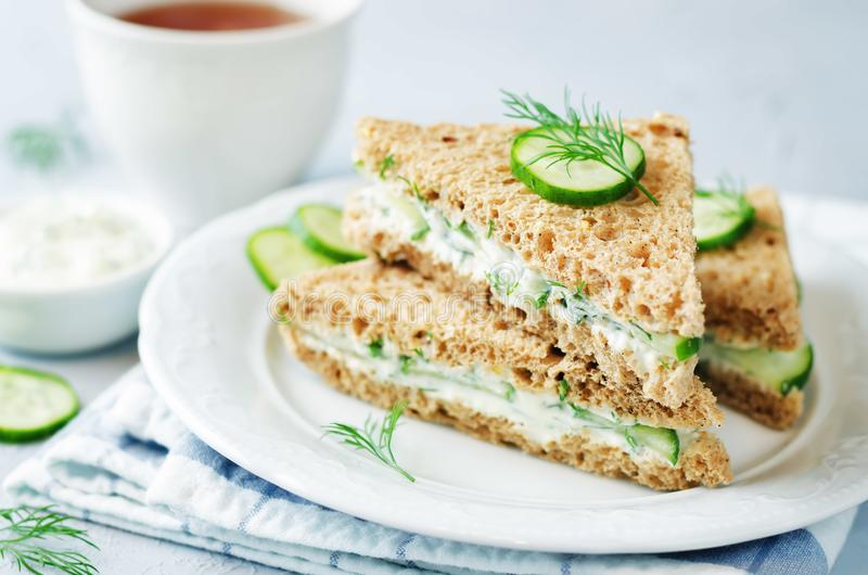 Cream cheese dill cucumber english tea sandwiches. Toning. selective focus stock photography