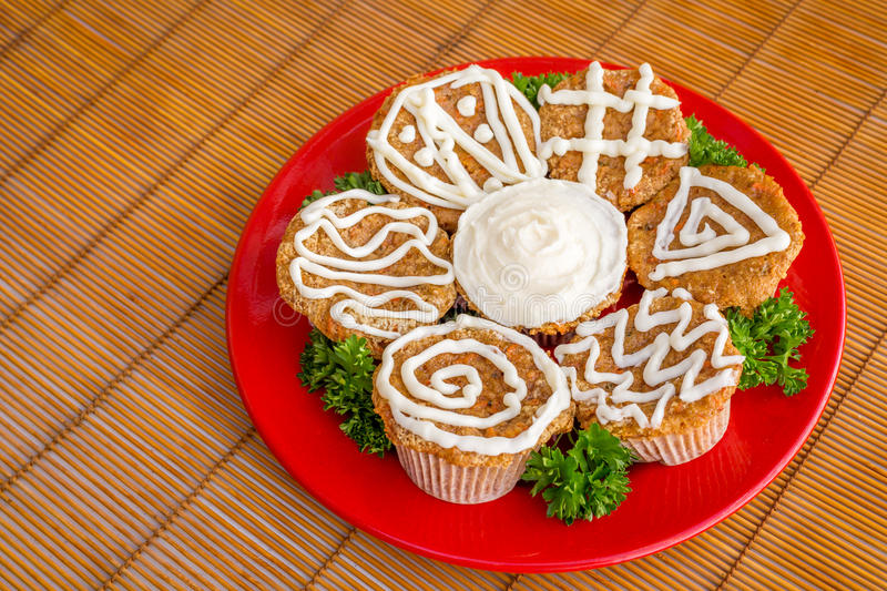 Cream cheese frosted carrot cake cupcakes. A delicious treat stock photo