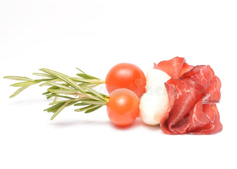 Cream cheese roll ups appetizer with prosciutto. On white royalty free stock images
