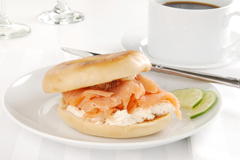 Cream cheese and salmon bagel royalty free stock images