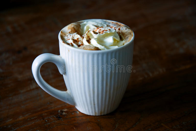 Cream, cinnamon and coffee royalty free stock images