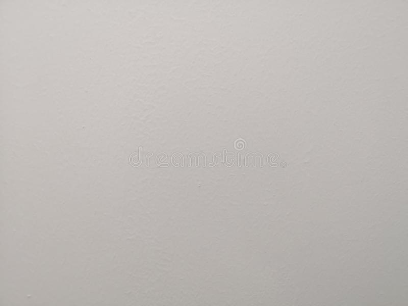 Cream color painting of polished surface on concrete plastering background. Cream color painting of polished surface  on concrete plastering background or royalty free stock images