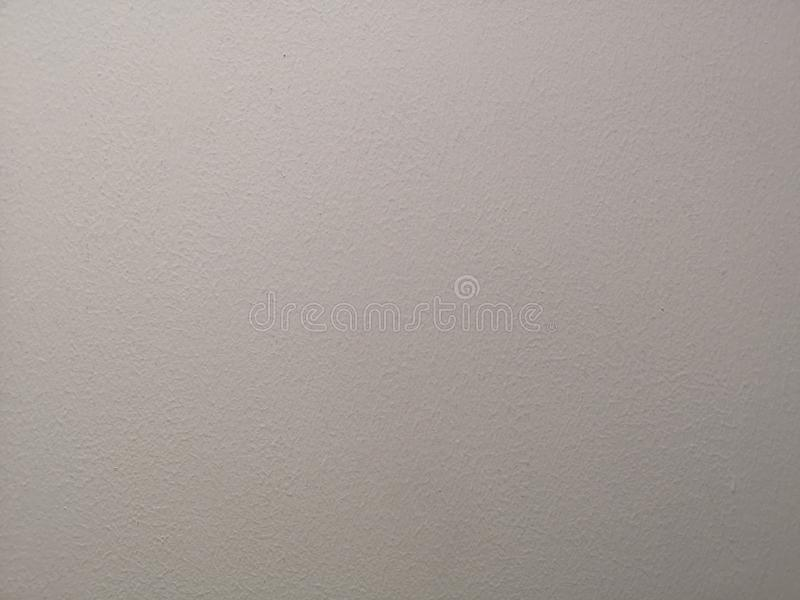 Cream color painting of polished surface on concrete plastering background. For backdrop stock photos