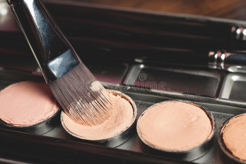 Cream concealer palette in metal case. Professional cosmetic. Cream concealer. Working with skin defects royalty free stock photo