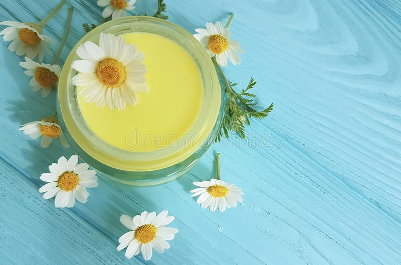 Cream cosmetic daisy chamomile natural handmade protection freshness extract on a blue wooden background. Cream cosmetic daisy a blue wooden background chamomile stock illustration
