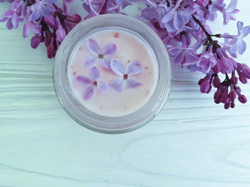 Cream cosmetic scrub lilac flower moisturizer aromatic treatment on white wooden anti aging homemade harmony spa stock photo