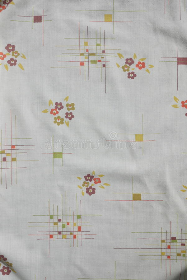 Cream flower and geometric Vintage real fabric 1970s cotton pattern royalty free stock photo