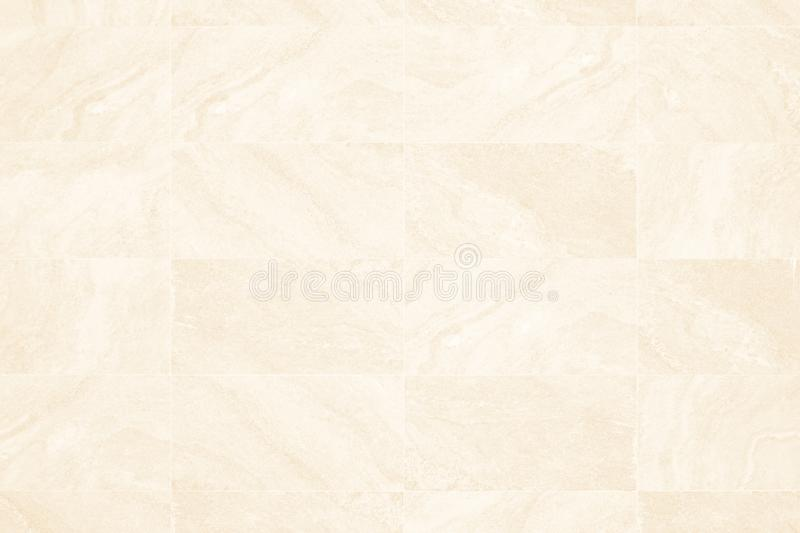 Cream granite texture and background or slate tile ceramic, seamless texture square light  beige. Marble tiles seamless floor royalty free stock photos