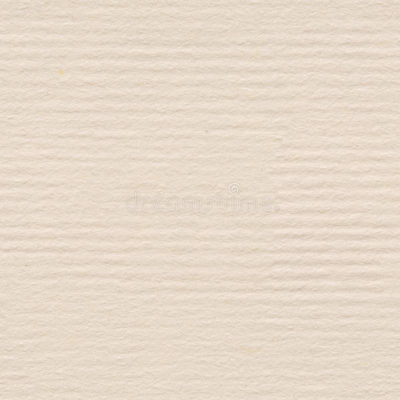 Cream, handmade paper texture. Seamless square background, tile. Ready. High quality texture in extremely high resolution royalty free stock image