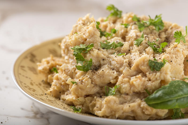 Cream made from mashed chicken breast with herbs and ground black pepper. On plate stock image
