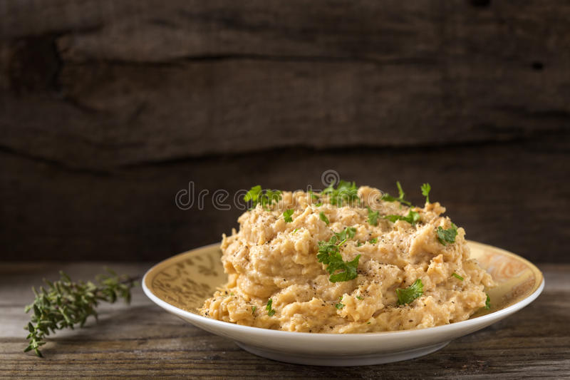 Cream made from mashed chicken breast with herbs and ground black pepper on wood. Cream made from mashed chicken breast with herbs and ground black pepper on stock photography