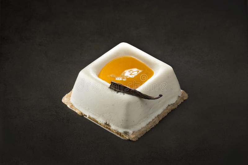 Cream and mango dessert on a black background stock photography