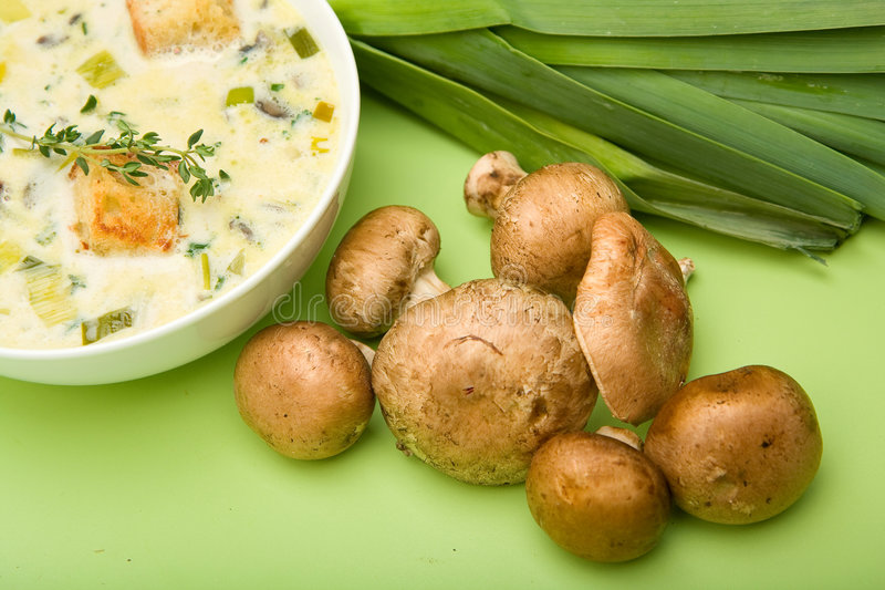 Cream of Mushroom and Leek soup. Presented with Mushrooms and Leeks royalty free stock image