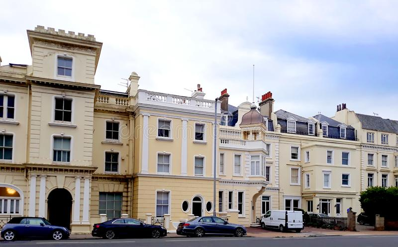 Victorian houses and apartments in Hove. Cream painted Victorian residential buildings on King way in Brighton and Hove royalty free stock photography