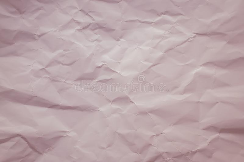 Cream paper background. Pastel, soft pink color. Vintage texture of creased sheet. Painted crumpled page, pattern. Copy space. Lig. Ht red wrinkled cardboard royalty free stock photos