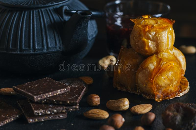 Cream puff cake with caramel icing and pieces of dark chocolate. Traditional french and Italian pastry. Delicious stock photos