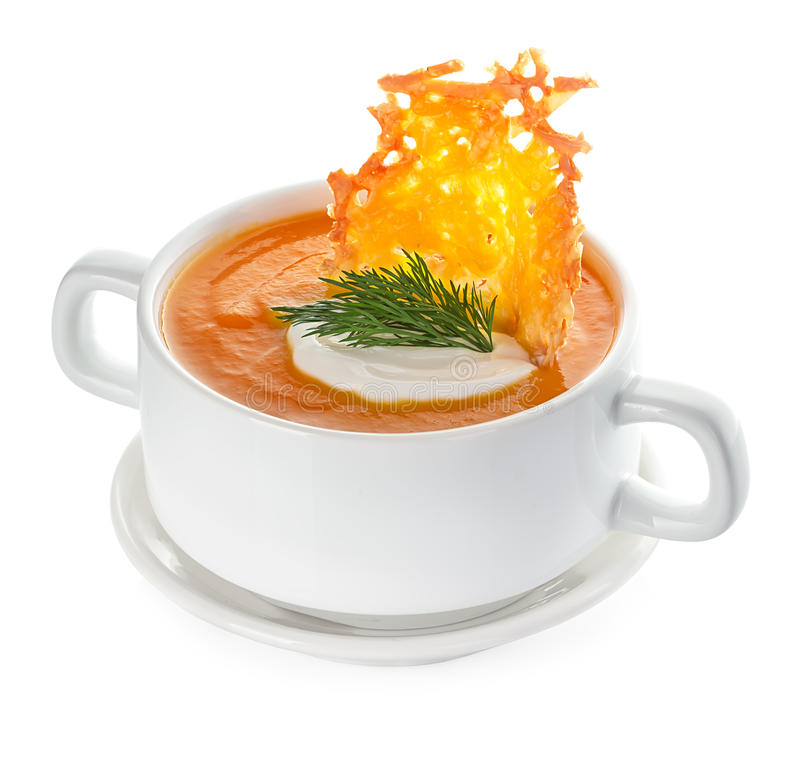 Cream of pumpkin soup with parmesan crisps royalty free stock photography